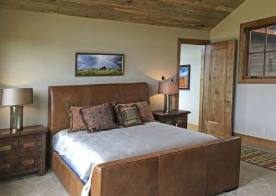 bedroom in custom home built by rivertree building
